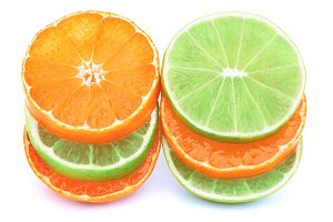 Stack of tangerines and limes slices isolated