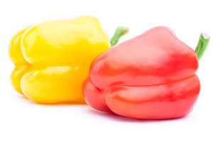 Red and yellow bell peppers isolated