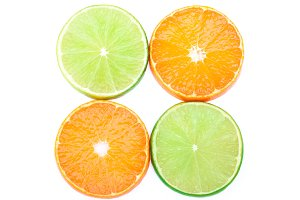 Tangerines and limes slices isolated