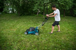 man working with lawn mower