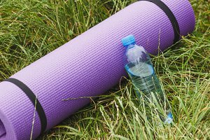 Sport's or yoga's equipment on the green grass