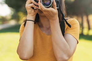 Woman using a camera to take photo.