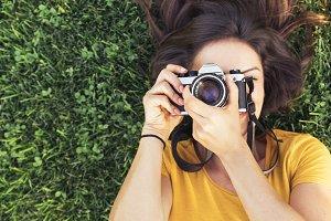 Woman using a camera to take photo.
