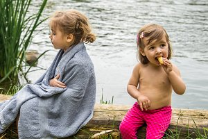 Kids hide with a towel