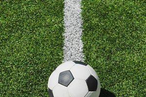 soccer ball lying on soccer pitch