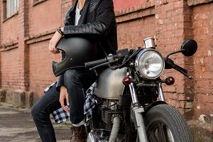 Handsome man and cool caferacer bike