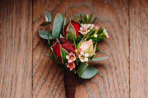 Boutonniere groom on a wooden background