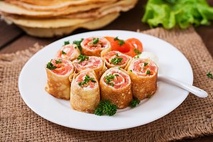 Appetizing pancakes with salmon