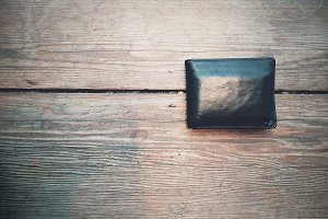 Leather Wallet on Wood Table