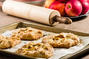 Warm apple tarts on tray