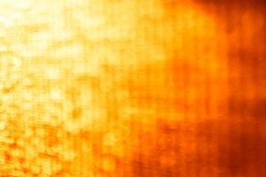 Horizontal orange vivid bokeh backdrop