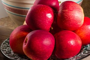Red apples and bowl