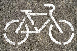 Bicycle symbol on textured asphalt background