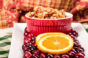 Fresh cranberries with orange slices