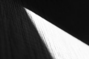 Diagonal perspective black and white light and shadow compositio