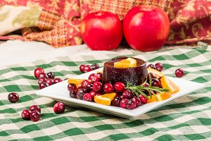 Cranberry sauce and red apples