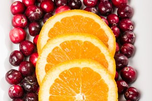Cranberries and sliced oranges