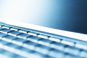 Diagonal perspective laptop keyboard bokeh background