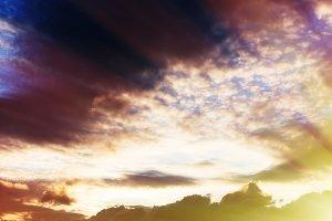 Horizontal dramatic cloudscape with sunshine background