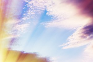 Vertical dramatic cloudscape with sun rays background