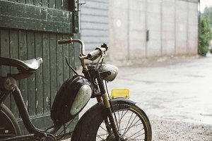 Old moped in the rain