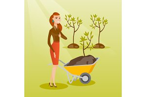 Woman pushing wheelbarrow with plant.