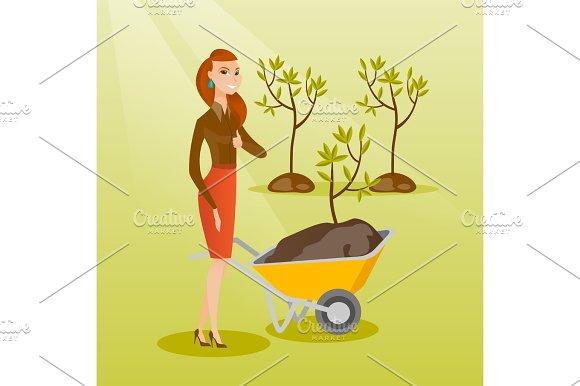Woman Pushing Wheelbarrow With Plant