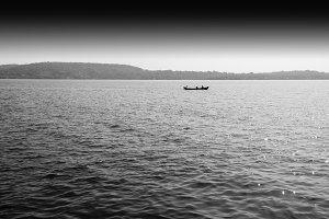Horizontal black and white boat in ocean horizon landscape backg