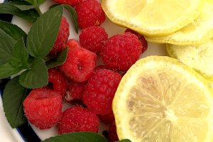 Raspberries and lemon slices