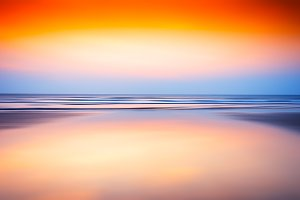 Horizontal ocean sunset blurred background