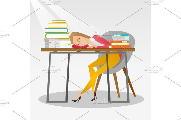 Female Student Sleeping At The Desk With Book
