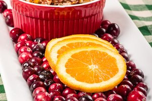 Plate with cranberries and oranges