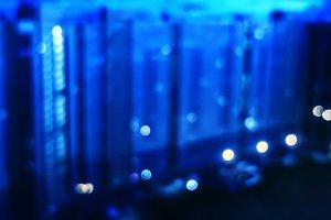 Horizontal blurred blue background of night city