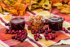 Jars of cranberry sauce and berries