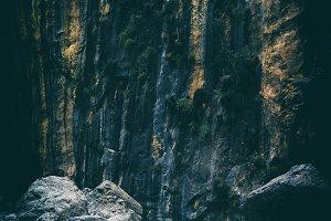 Vertical vintage pale stone rock mountain texture backdrop