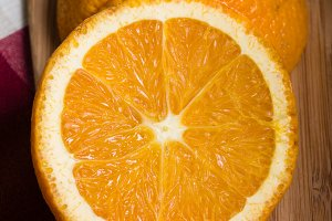 Orange cut on board