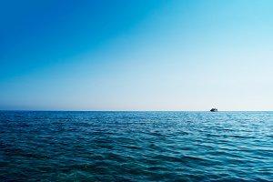 Horizontal blue ocean ship on horizon background