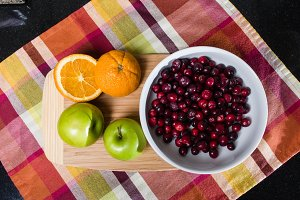 Overhead cutting board with fruit