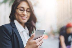 Woman reading message via cellphone