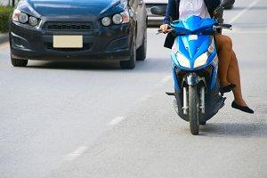 Women riding a sccoter