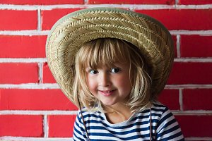 Happy little girl in hat