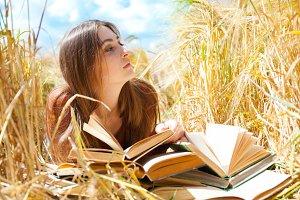Fashion beautiful girl with book