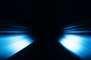 Diagonal blue rays bokeh background