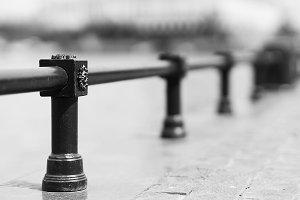 Diagonal black and white fence bokeh background