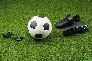 stopwatch with soccer ball and boots