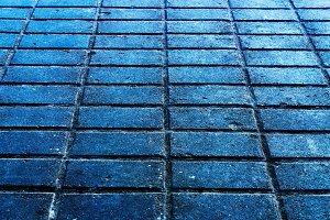 Horizontal blueish street brick texture background backdrop