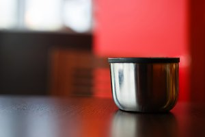Horizontal cup of hot tea bokeh background