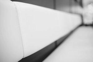 Diagonal black and white bench bokeh background