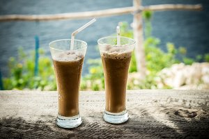 Glasses Of Cold Coffee On Wood outside. Tropical island, Indonesia, Asia.