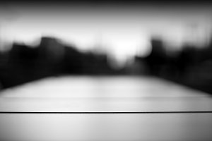 Horizontal black and white dramatic city bokeh background